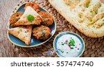 indian snacks   pakora  samosa  ...   Shutterstock . vector #557474740