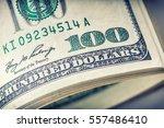 dollars rolled closeup.... | Shutterstock . vector #557486410