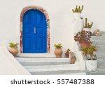 Blue Door Of Beautiful White...