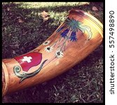 Small photo of Decorated front part of a Swiss alphorn.