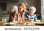 happy family in the kitchen.... | Shutterstock . vector #557512594