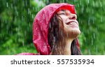 the young woman smiles and... | Shutterstock . vector #557535934