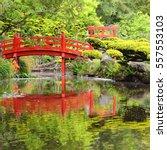 red bridge over water in...
