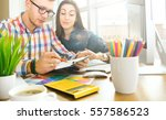 cute creative designers working ... | Shutterstock . vector #557586523