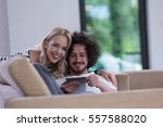 young couple relaxing at... | Shutterstock . vector #557588020