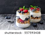 healthy blueberry and raspberry ... | Shutterstock . vector #557593438