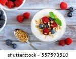 greek yogurt with sweet berries ... | Shutterstock . vector #557593510