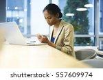 busy skilled female leader of... | Shutterstock . vector #557609974