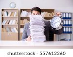 businessman struggling to meet... | Shutterstock . vector #557612260