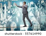 man walking in tight rope... | Shutterstock . vector #557614990