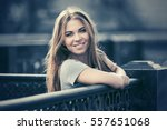 happy young woman on city... | Shutterstock . vector #557651068
