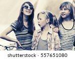 group of happy teen girls on... | Shutterstock . vector #557651080