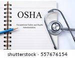 Small photo of Stethoscope on notebook and pencil with Occupational Safety and Health Administration OSHA words as medical concept