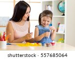child girl and mom play with... | Shutterstock . vector #557685064