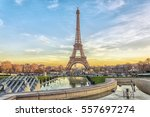 eiffel tower at sunset in paris ... | Shutterstock . vector #557697274