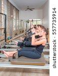 young women exercising on...   Shutterstock . vector #557735914