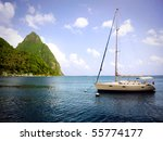 A sailboat and Gros Piton in St. Lucia. - stock photo