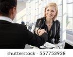 smiling businesswomen shaking
