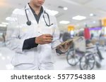 doctor hand holding the tablet...   Shutterstock . vector #557754388