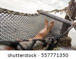 feet and legs of a girl lying... | Shutterstock . vector #557771350