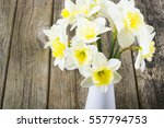 white daffodils at china vase... | Shutterstock . vector #557794753