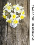 white daffodils at china vase... | Shutterstock . vector #557794963