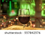 a glass of red wine on a... | Shutterstock . vector #557842576