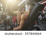 muscular fitness woman doing... | Shutterstock . vector #557844064
