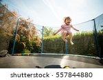 Little Child Enjoys Jumping On...