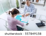 confident advisor meeting with... | Shutterstock . vector #557849158
