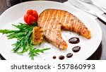 grilled salmon steak on a plate | Shutterstock . vector #557860993