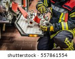 firefighter in action to the... | Shutterstock . vector #557861554