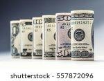 rolled american dollars... | Shutterstock . vector #557872096