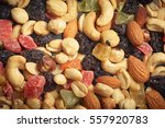 dried fruits and nuts texture | Shutterstock . vector #557920783