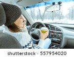 charming businesswoman drinking ... | Shutterstock . vector #557954020
