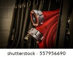 fire hose rolled up in the fire ... | Shutterstock . vector #557956690