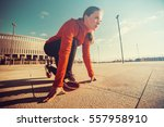 sportswoman in ready position... | Shutterstock . vector #557958910