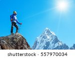 hiker with backpacks reaches... | Shutterstock . vector #557970034