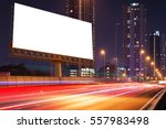 Small photo of Left blank billboard on light trails, street and urban in the night - can advertisement for display or montage product or business.
