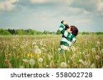 child watching in benoculars on ... | Shutterstock . vector #558002728