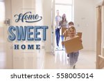family carrying boxes into new... | Shutterstock . vector #558005014