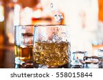 whiskey glass with ice and ... | Shutterstock . vector #558015844