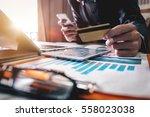 business man hands using laptop ...   Shutterstock . vector #558023038