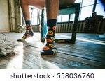 men's feet in funny socks | Shutterstock . vector #558036760