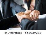 hand group teamwork join hands... | Shutterstock . vector #558039283