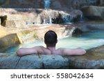 men relaxing in a swimming pool ... | Shutterstock . vector #558042634