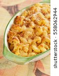 Small photo of Oven baked mac and cheese, american style macaroni pasta with cheesy sauce