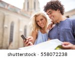 happy young tourists searching... | Shutterstock . vector #558072238