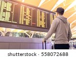 passenger looking at departures ... | Shutterstock . vector #558072688