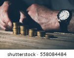 man in business casual stacking ... | Shutterstock . vector #558084484